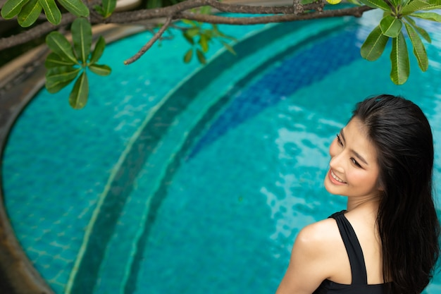 Beautiful cute girl wear black swim suit bikini