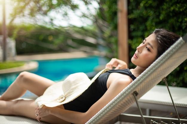 Beautiful cute girl wear black swim suit with hat