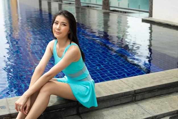 Beautiful cute girl wear blue swim suit bikini