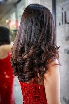 Beautiful dark hair are finally setting in salon ready for her party