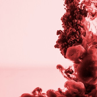 Beautiful dark red cloud of ink