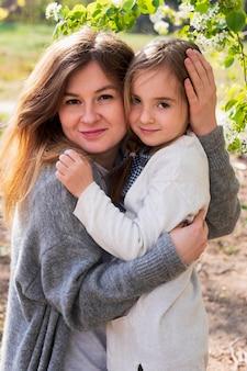 Beautiful daughter and mother posing