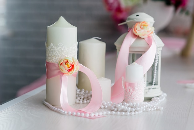 Beautiful decor of candles and flowers. white pink shades.