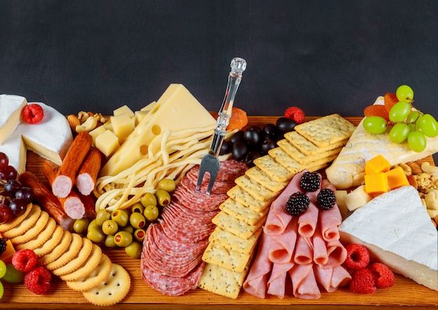 A beautiful decor of fresh cheese and meat crackers, green olives