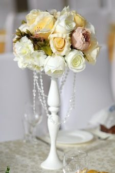 Beautiful decorated table set for wedding party, wedding decorations with flowers