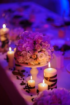 Beautiful decorated table with flower decorations and candles