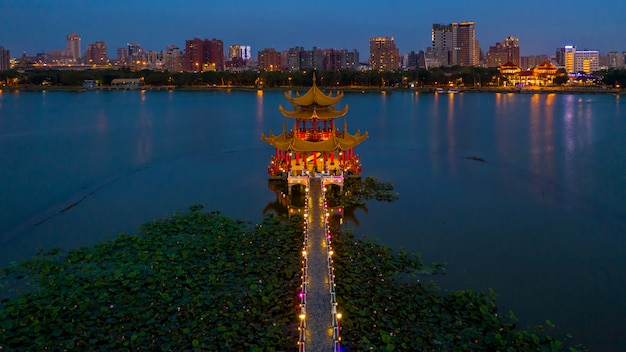 Beautiful decorated traditional chinese pagoda with kaohsiung city, waiting, kaohsiung, taiwan.