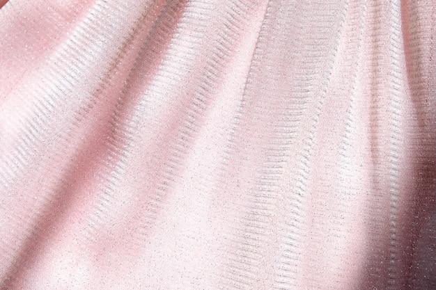 Beautiful delicate pink background. shiny mesh fluffy fabric close-up texture