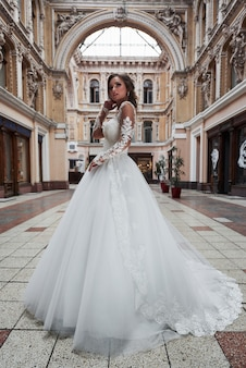 Beautiful delicate young woman, bride in luxurious wedding dress