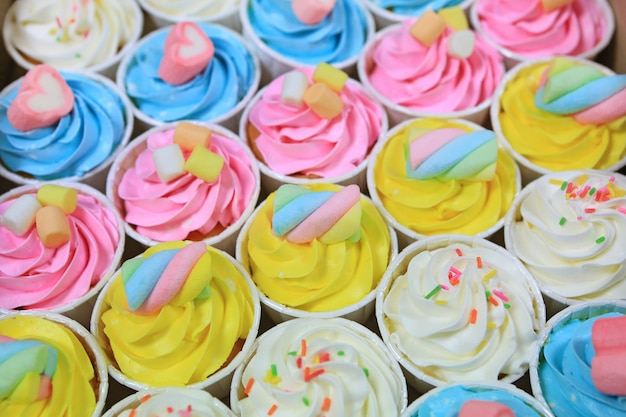 Beautiful delicious cupcakes background.