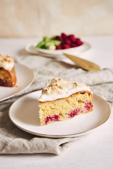 Beautiful and delicious raspberry and rhubarb cake with ingredients on a table