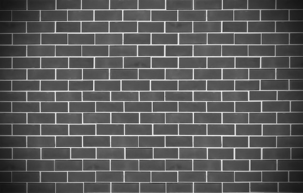 Beautiful design textured of old black bricks wall background.