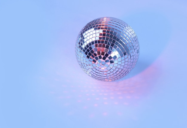 Beautiful disco ball on yellow background isolated.photo with copy space