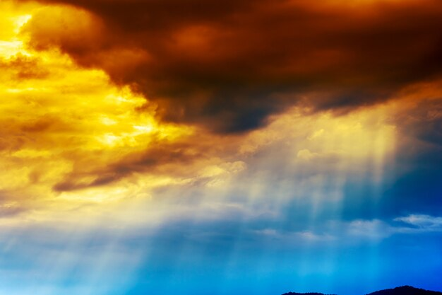 Beautiful dramatic cloudscape sunset sky with sun rays