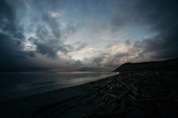 Beautiful dramatic shot of coast of the ocean with breathtaking sky