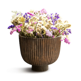 Beautiful dry flower in wooden vase for decoration isolated on white