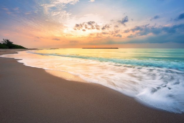 Beautiful early morning sunrise over the sea the horizon at hat chao samran beach in phetchaburi thailand.