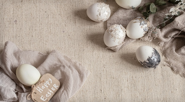 Beautiful easter eggs scattered on the textured fabric. easter decor concept.