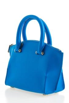 Bella eleganza e donne di lusso di moda e borsa blu