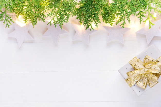 Beautiful elegant christmas new year background. stars sparkling golden garland juniper