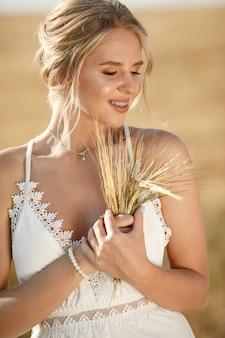 Beautiful elegant girl in a autumn field