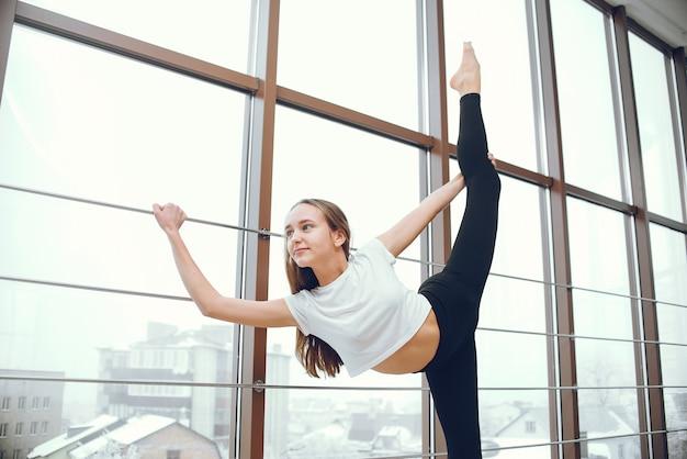 Beautiful and elegant girl doing yoga