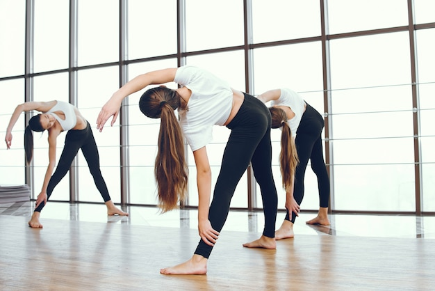 Beautiful and elegant girls doing yoga