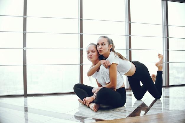 Beautiful and elegant girls doing yoga