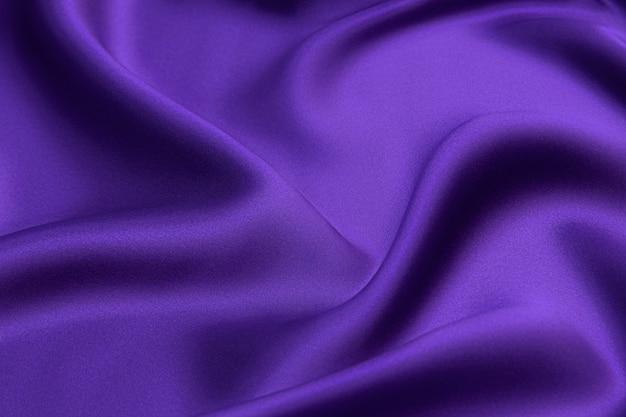 보라색 배경 디자인으로 아름다운 우아한 물결 모양의 보라색 새틴 실크 고급 천 패브릭 질감.