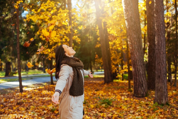 Beautiful elegant woman in autumn park. fall yellow forest