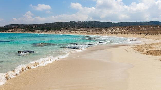 A beautiful empty blue water,white sand beach in karpasia region, cyprus.paradise island