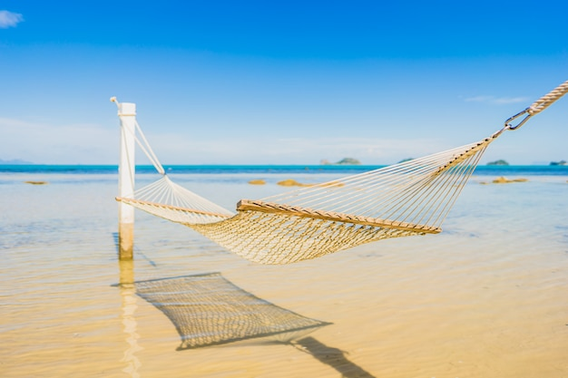 Beautiful empty hammock around tropical beach sea ocean for holiday vacation