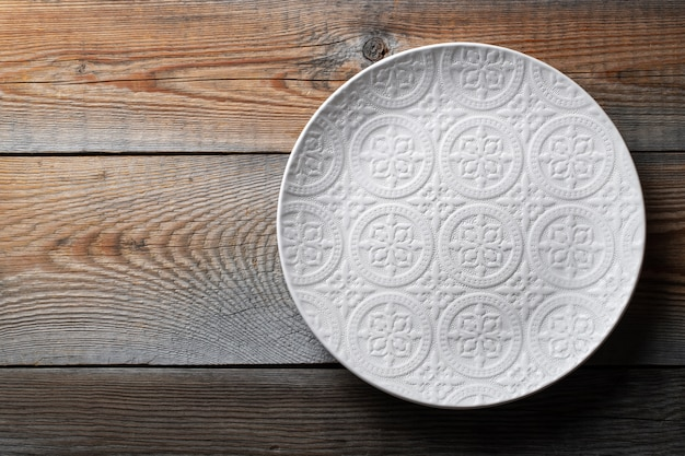 Beautiful empty white plate with ornament.
