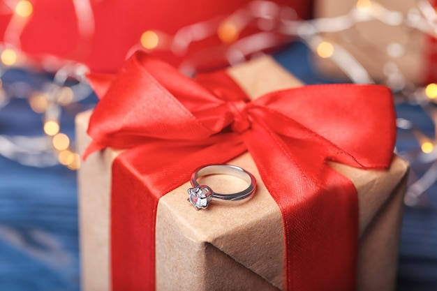 Beautiful engagement ring on gift box, closeup