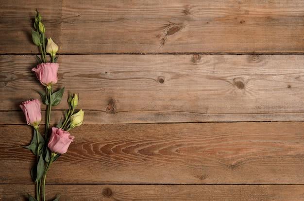 Beautiful eustoma on wooden surface
