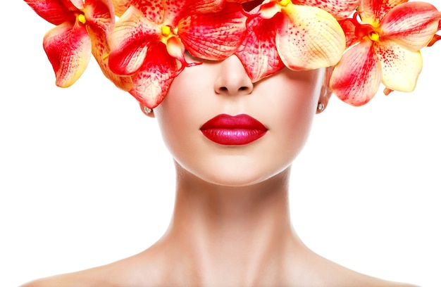 Beautiful face of  woman with bright lipstick on a lips and pink flowers- isolated on white