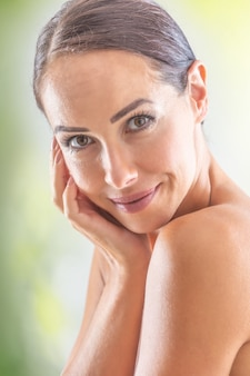 Beautiful face of young adult woman with clean  skin without make-up. spa skincare wellness and cosmetics concept.