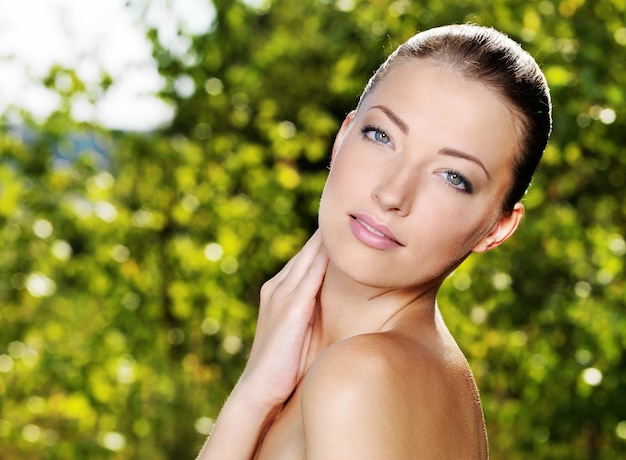 Beautiful face of an young woman with fresh health skin.