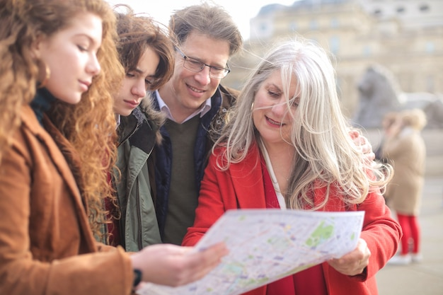 Beautiful family consulting a city map