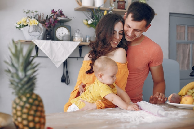 Beautiful family prepare food in a kitchen