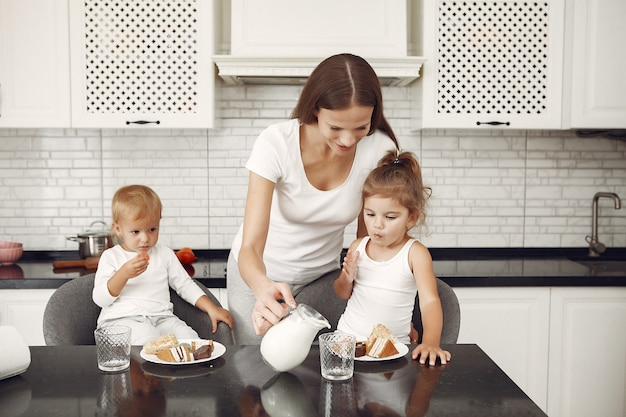 Beautiful family spend time in a kitchen