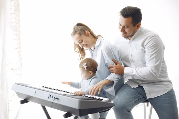 Beautiful family spend time in a music studio