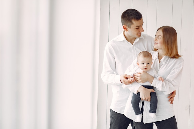 Beautiful family standing on white