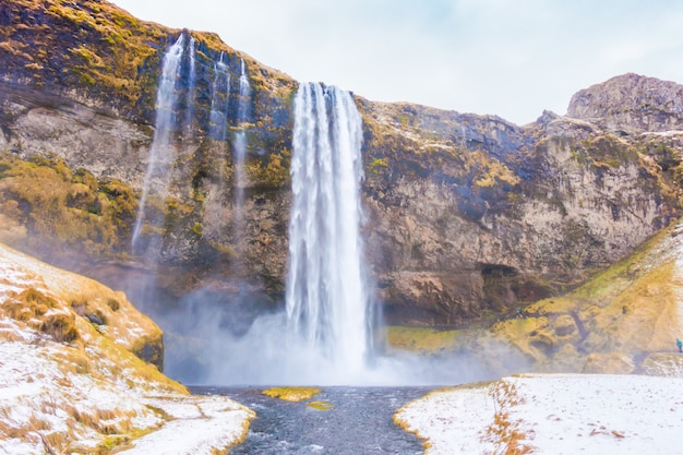 Beautiful famous waterfall in iceland, winter season