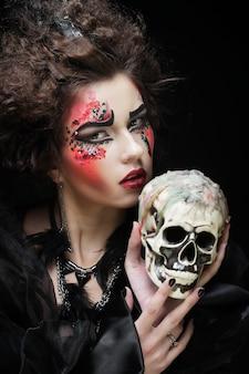 Beautiful fantasy woman with skull, halloween theme,
