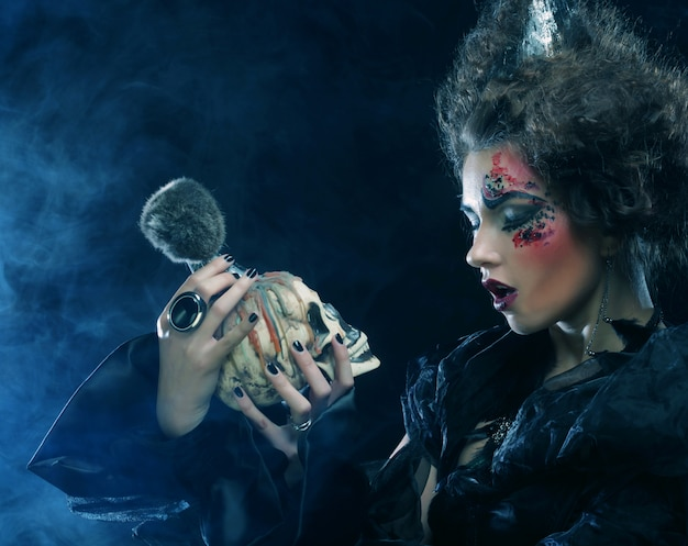 Beautiful fantasy woman with skull
