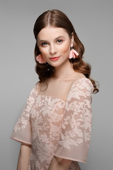 Beautiful fashion bride in peach lace dress. clean fresh face of pretty girl with natural makeup.