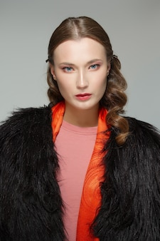 Beautiful fashion model in fur coat. clean fresh face of pretty girl with natural makeup.