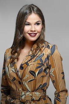Beautiful fashion model in jacket with print. clean fresh face of pretty girl with natural makeup.