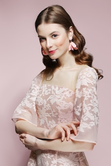 Beautiful fashion model in lace dress. clean fresh face of pretty girl with natural makeup.